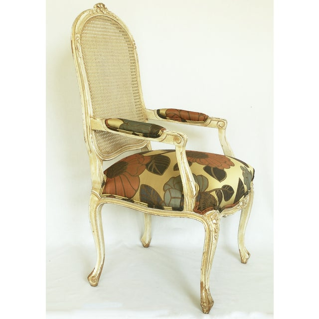 Newly re-upholstered on new foam in large pattern floral designer fabric. The glaze finish in this chair was partially...