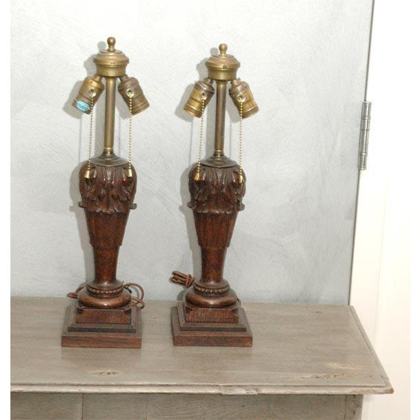 This pair of carved wood table lamps (probably from 18th century bed post and converted circa 1920), have dual light...