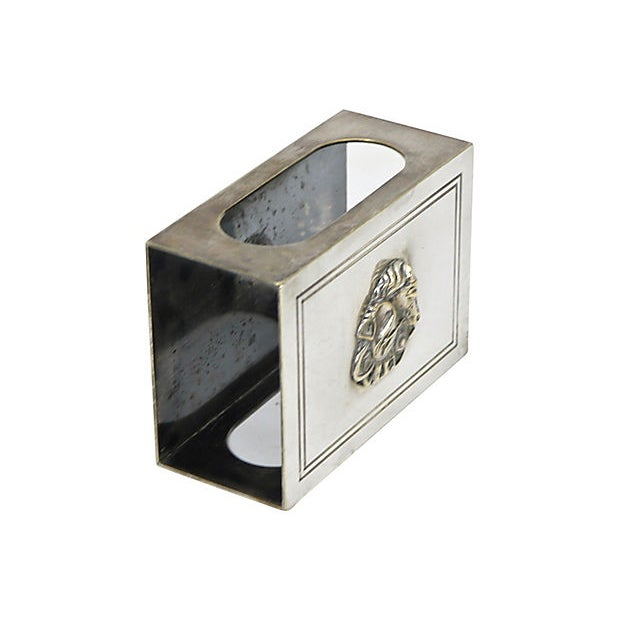 Christian Dior silver-plate match box holder with a horse racing motif. Maker's mark on underside. Light wear.