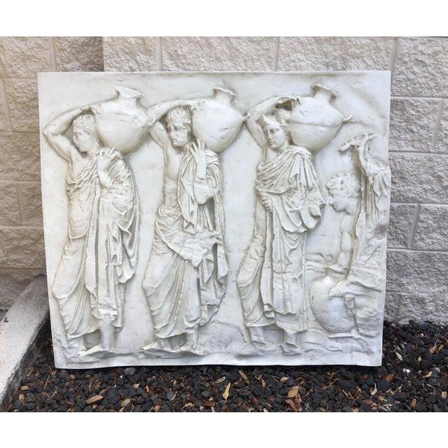 A three dimensional fiberglass wall sculpture. The piece explores artistic rendering of human form.