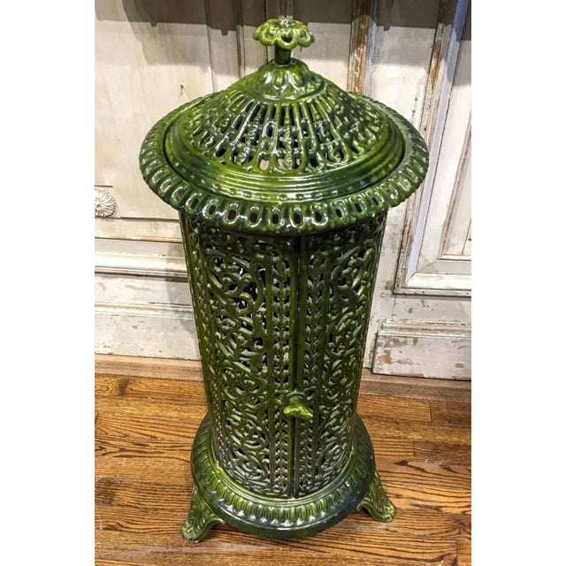 A French Art Nouveau period enameled, scrolled cast iron parlor heating stove from the 19th century, repurposed into...