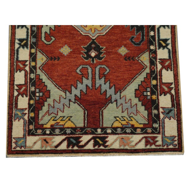 This beautiful vintage Turkish Oushak rug is hand-knotted, 100% wool, made in Turkey, Ushak region. It features a...