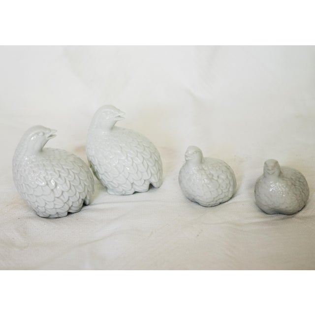 A charming set of four porcelain quails, two large and two small.