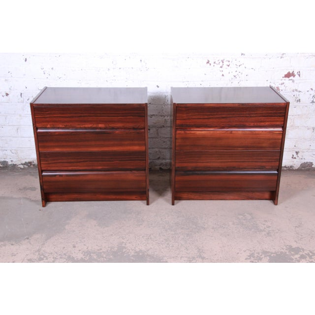 An exceptional pair of mid-century Danish Modern dressers or bedside chests in book-matched rosewood In the manner of Hans...