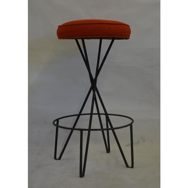 1950's metal and fabric bar stool designed by Paul Tuttle. It has hair pin shaped legs and a circular foot rest. The...