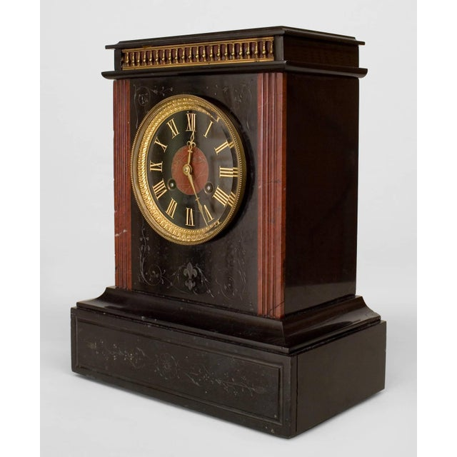 French black marble mantel clock with rosso antic marble column sides and a face numbered in etched and gilded roman...