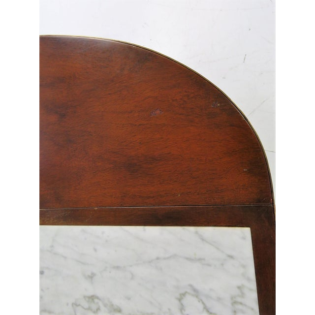 Marble top. Drop leaf front. 2 shelves. Mahogany carved frame. Wear and scratches to marble.