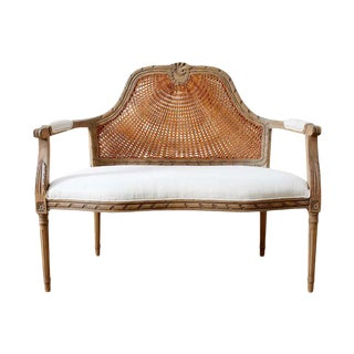 French Louis XVI Style Caned Back Linen Settee For Sale