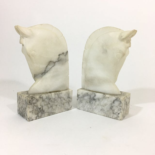 Stunning pair of grey and white marble trojan horse head bookends. Perfect addition to your bookcase or etagere. Hand...