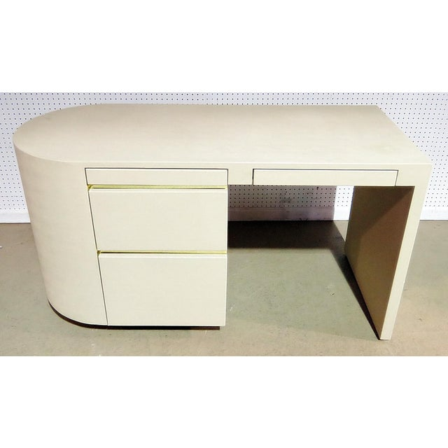 Mid-Century modern 4 drawer desk with gilt metal trim.
