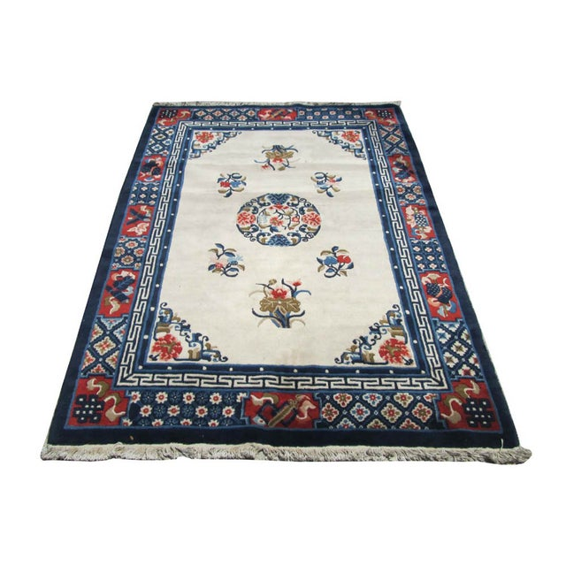 "This blue & cream white color rug is made of wool blend and has peony flowers graphic. Dimensions: 47"" x 76.5"" Origin:..."