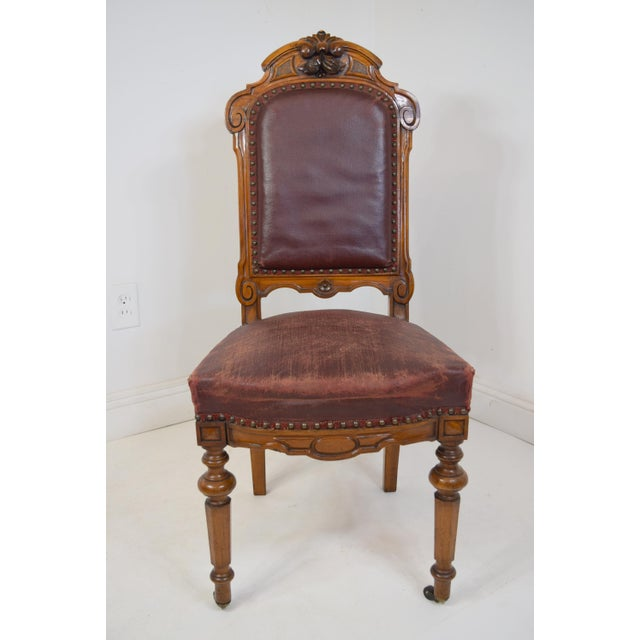 Mid 19th-Century Carved Walnut Dining Chairs. Carved fruit at the top of the backs--all different. At the perfect angle,...