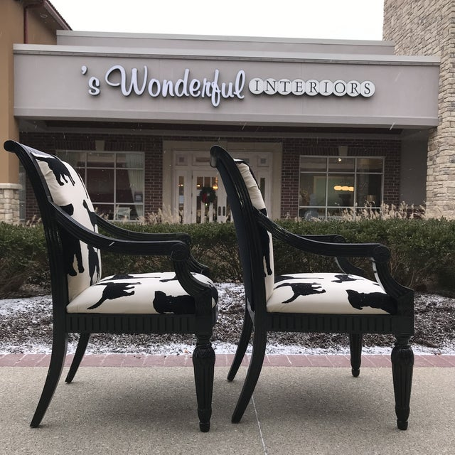 Pair of black lacquered host chairs upholstered in Designers Guild Best In Show. Constructed in 58%Silk and 42% Cotton....