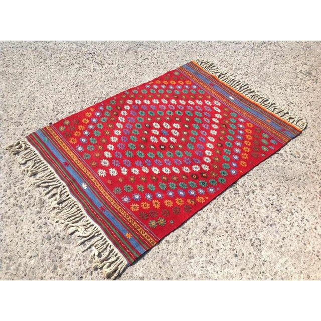 This vintage Turkish kilim rug was made of wool and cotton in 1970s in Turkey. It was professionally cleaned, and ready to...
