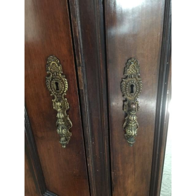 From the 19th Century this dark wood armoire has had recent deep wood conditioning during professional restoration with...