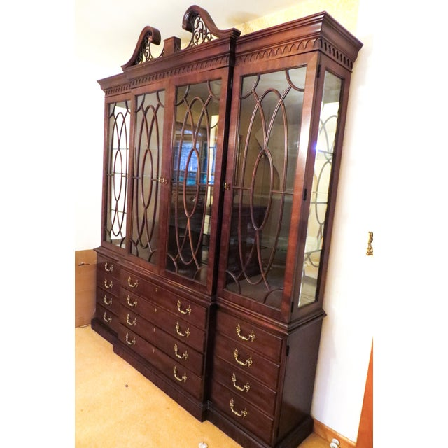 This is a mahogany Henredon four door china cabinet. Tittenhouse square. It has been in the family for a long time and it...