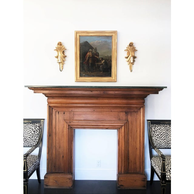 An original Edwardian fire surround in mahogany wood. The surround with a raised shelf above and green marble top. The...