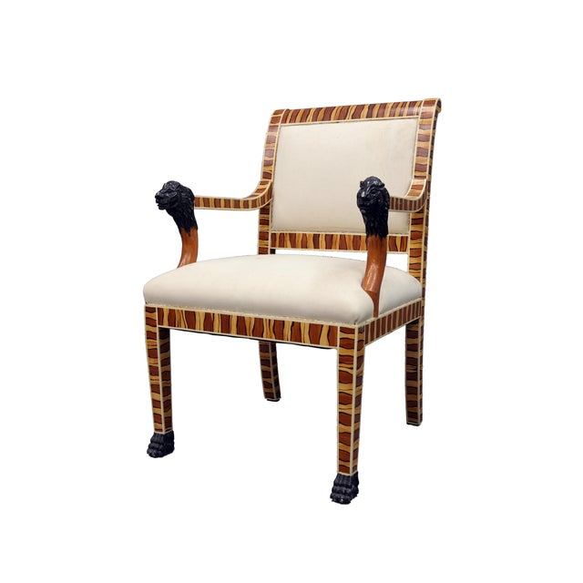 Upholstered hand painted Faux wood Arm chair with black lion faced arm rests. Stripes of yellow and brown color painted on...
