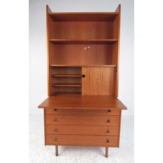 Nicely detailed and compact, with multiple storage options, this Danish design provides an efficient workspace in a small...