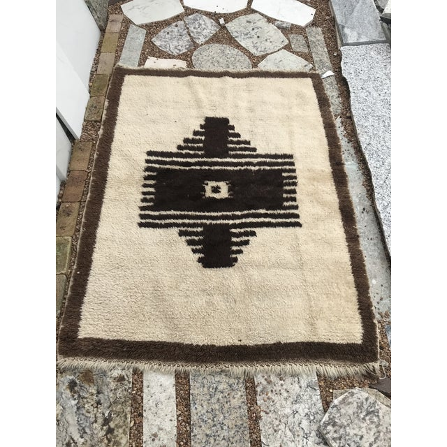 This squarish rug is called a Tulu which means long-haired. The wool is handspun and it was originally used as bed/bedding...