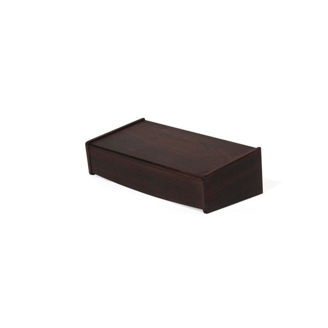 Pair of Rosewood floating nightstands manufactured in Denmark, circa 1960s. Nightstand consists of one drawer for storage...