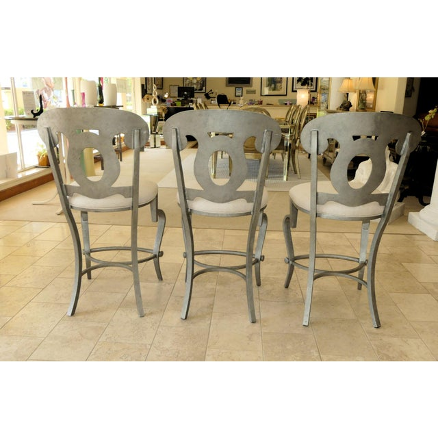 A sophisticated set of Biedermeier style counter height bar stools designed with a modern flare. Featuring metal...