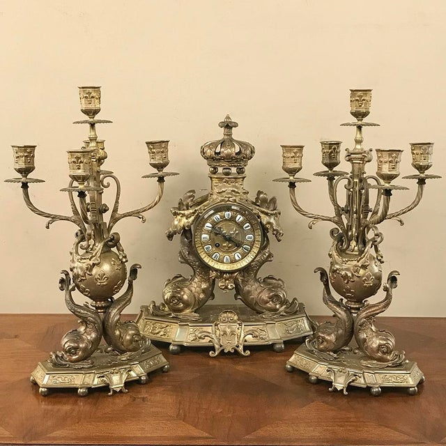 Pair 19th Century French Renaissance Dolphin Candelabra represent an extraordinarily elaborate artistic work in cast...