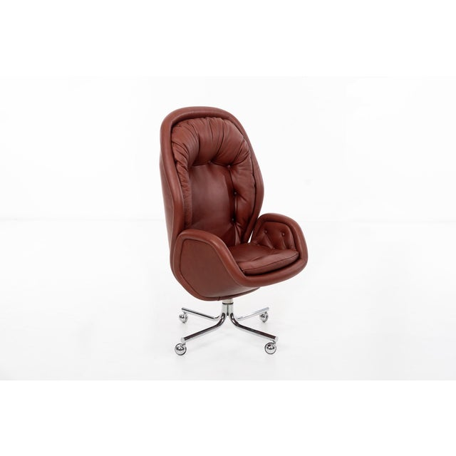 Sculptural executive desk chair by DoMore Chair Company. Newly upholstered with Spinneybeck leather, on chrome-plated...