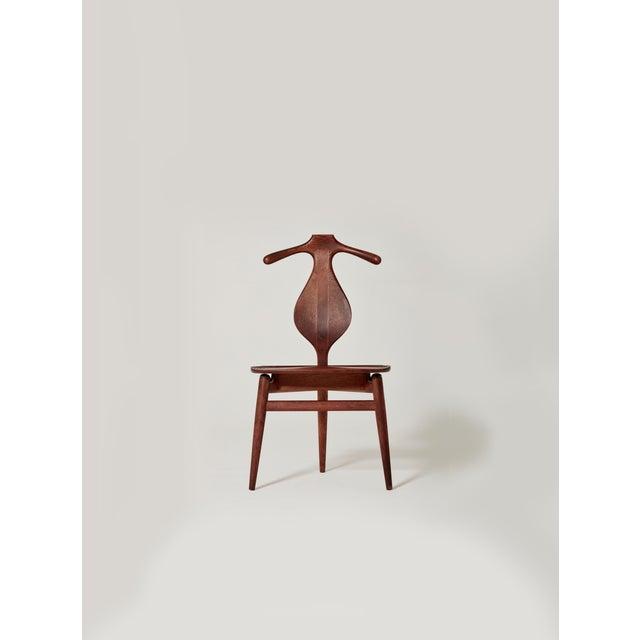 Hans Wegner Valet chair, designed in 1953 and made by Johannes Hansen, Denmark. Carved teak and oak frame with wonderful...