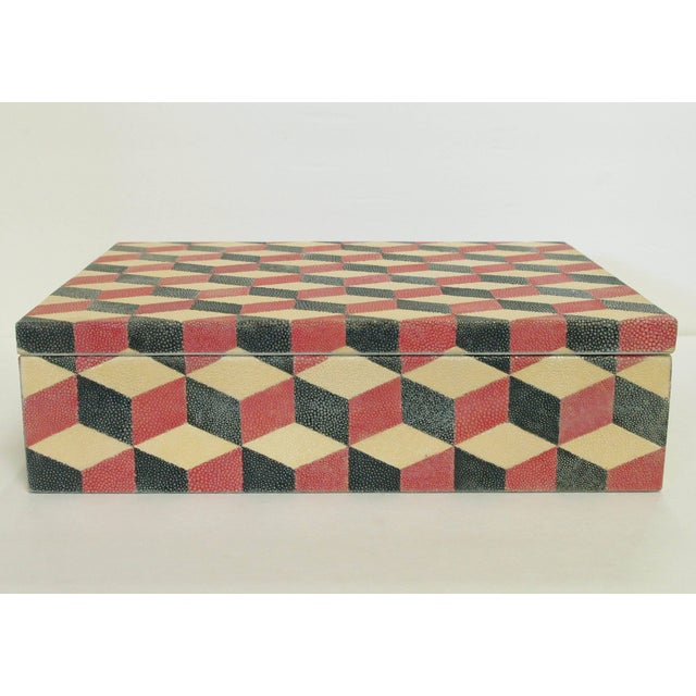 Box with cream, red, and black Shagreen diamond shaped pattern and gray suede interior by Fabio Bergomi / Made in Thailand...