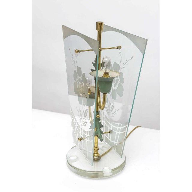 Very early Fontana Arte table lamp. Floral arrangement in brass tube and zinc lamp sockets, flanked by two glass-plates...