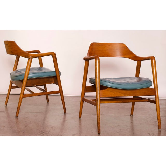 Pair of two Sculpted Side Chairs made of solid Walnut wood with the Original Leather Seats made by the The W. H. Gunlocke...