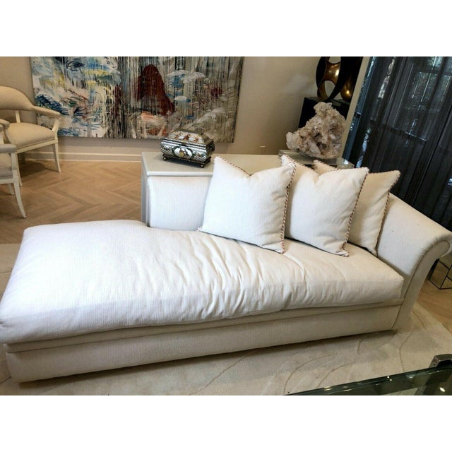 A beautiful custom made fainting couch or sofa with a left arm rest, rolled arms, hardwood legs and three pillows. This...