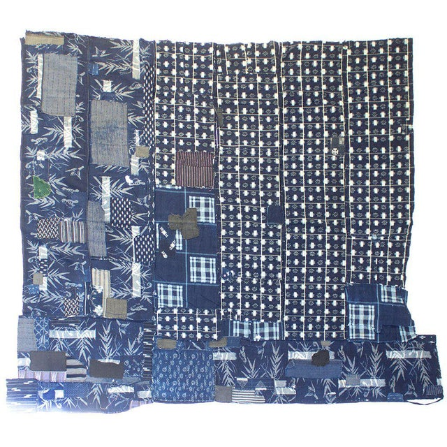 Hand sewn kasuri boro 襤褸 piece, possible a futon cover. Boro is a Japanese form of recycling coming from an economic...