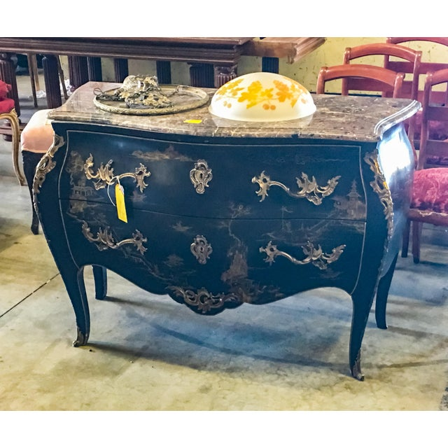 French Louis XV style (20th century '1932') black lacquered chinoiserie decorated commode with a bombe shape and two...