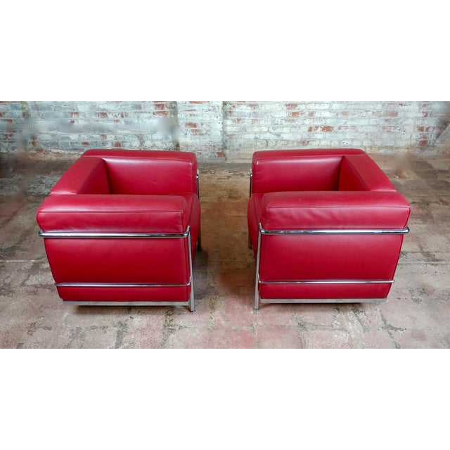 "Le Corbusier LC2 Red Leather Poltrona Armchair by Cassina-a Pair size 30 x 28 x 26"" seat height 20"" Excellent - Minor wear..."