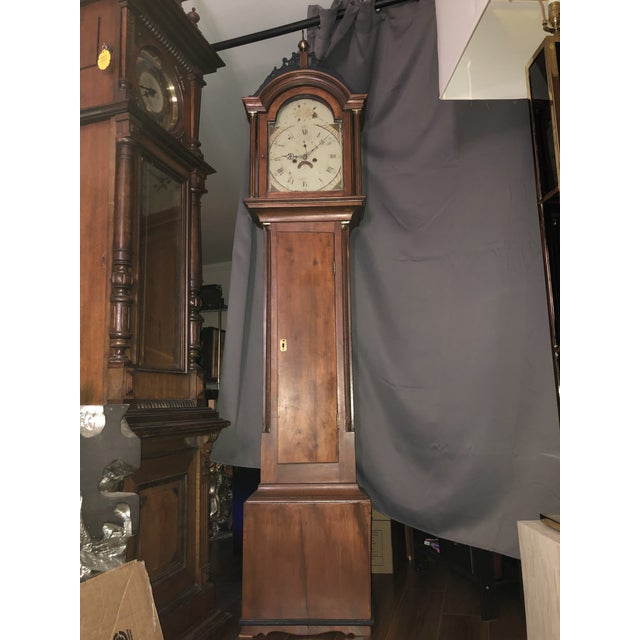 Up for sale is an early American tall case clock. The clock features a cherry wood case, a lattice top, 2 side windows,...