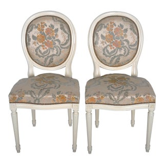 Pair of 1960's Louis XVI French Medallion Oak Dining Chairs W/ Carved Antique White Frame and White Embroidered Velvet Upholstery For Sale