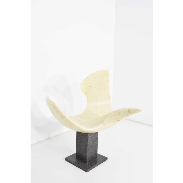 "Japanese Crane sculpture in marblized resin, signed. ""Bird in Flight""."
