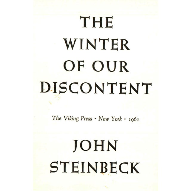 Winter of Our Discontent by John Steinbeck. New York: The Viking Press, 1961. First Edition. 311 pages. Hardcover with...