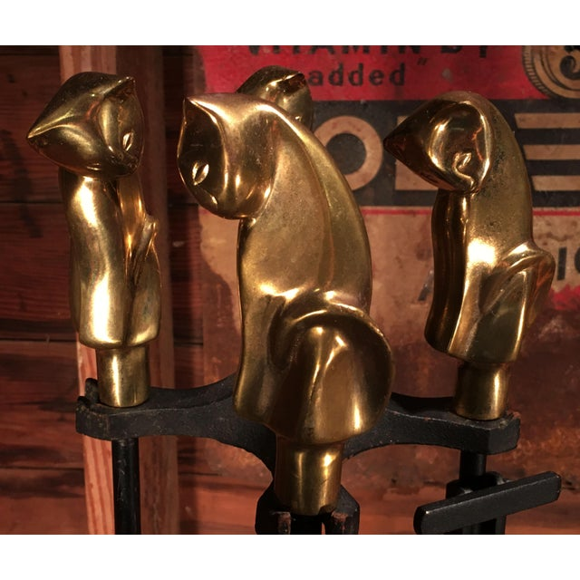 This is such a great set of vintage fireplace tools, with solid polished brass Art Deco or Mid-Century Modern stylized...