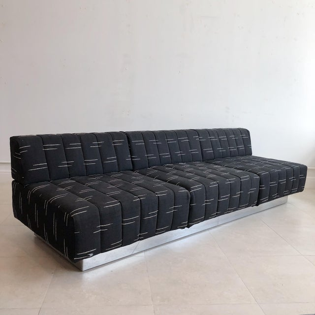 1960's vintage Harvey robber 3 seat sofa with steel over wood plinth base. In original as is fabric.
