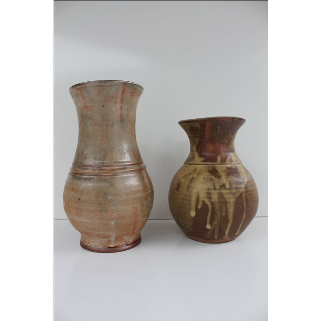 Vintage decorative studio art pottery vessel. Brown drip glazed by EVAN JON. Both pieces are signed by the artist. They...