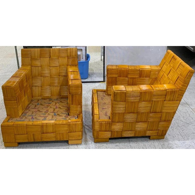 Pair of Donghia woven rattan block Island club chairs by John Hutton, Each one beautifully constructed and woven, warm...