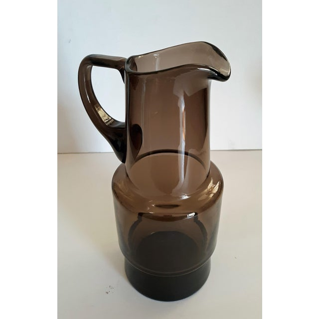 Mid Century Scandinavian blown art glass pitcher. Beautiful chocolate/smoke color. Attached handle. Excellent condition.