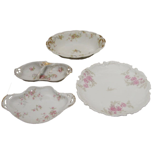 Lovely collection of antique French Limoges porcelain serving pieces consisting of a handled, pierced dish for nuts,...
