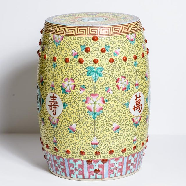 Fabulous large pair of Chinese Famille Rose Garden Stools. Great color combination, Yellow background with Turquoise Blue...