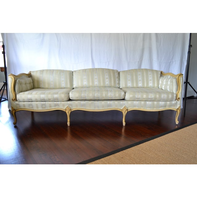 This fabulous vintage sofa has French Provincial style with the curves of Louis XV, mixed with the long and low mid-...