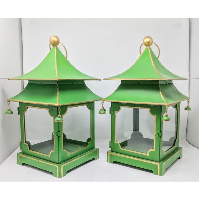 These set of two (2) handcrafted vintage two-tier tole pagoda lantern features a kelly green color base accented with...