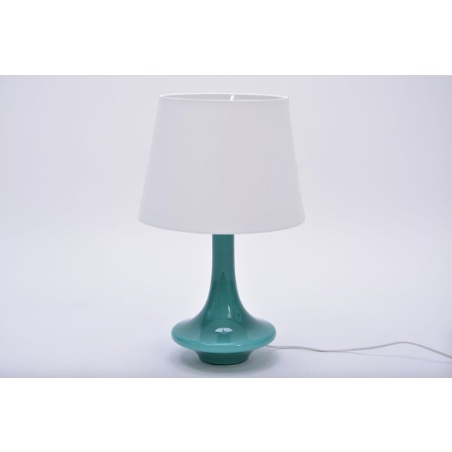 Vintage Mid-Century Scandinavian glass table lamp Designed by Esben Klint Produced by Le Klint in Denmark Dates from the...